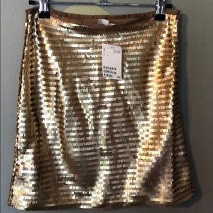 Gold sequin mini skirts